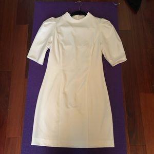 Black Halo cream minidress with open back